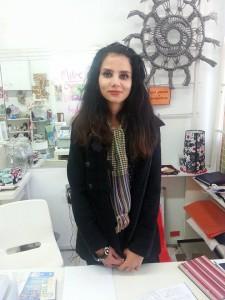 Mitra volunteering at the shop